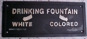 Segregated drinking fountain sign.