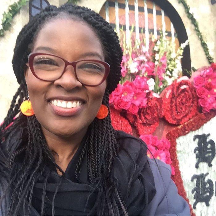 Aisha smiling in selfie aboard Rose Parade float.